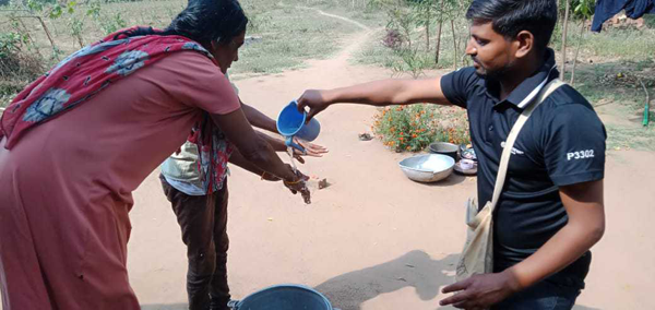 Villagers practice hand washing to combat the spread of the virus.
