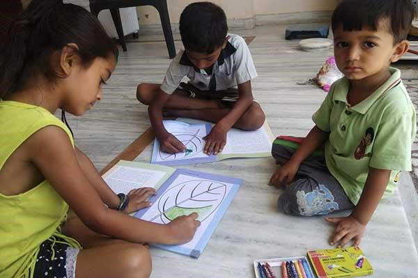 Young children with art kits supplied by village Lok Mitras.