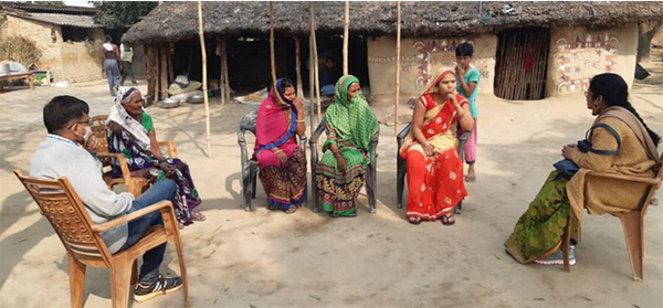 Women and volunteers gather in a Rural Women Livelihood Group.