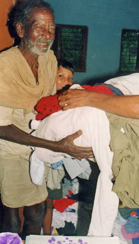 Man receiving clothing donation.